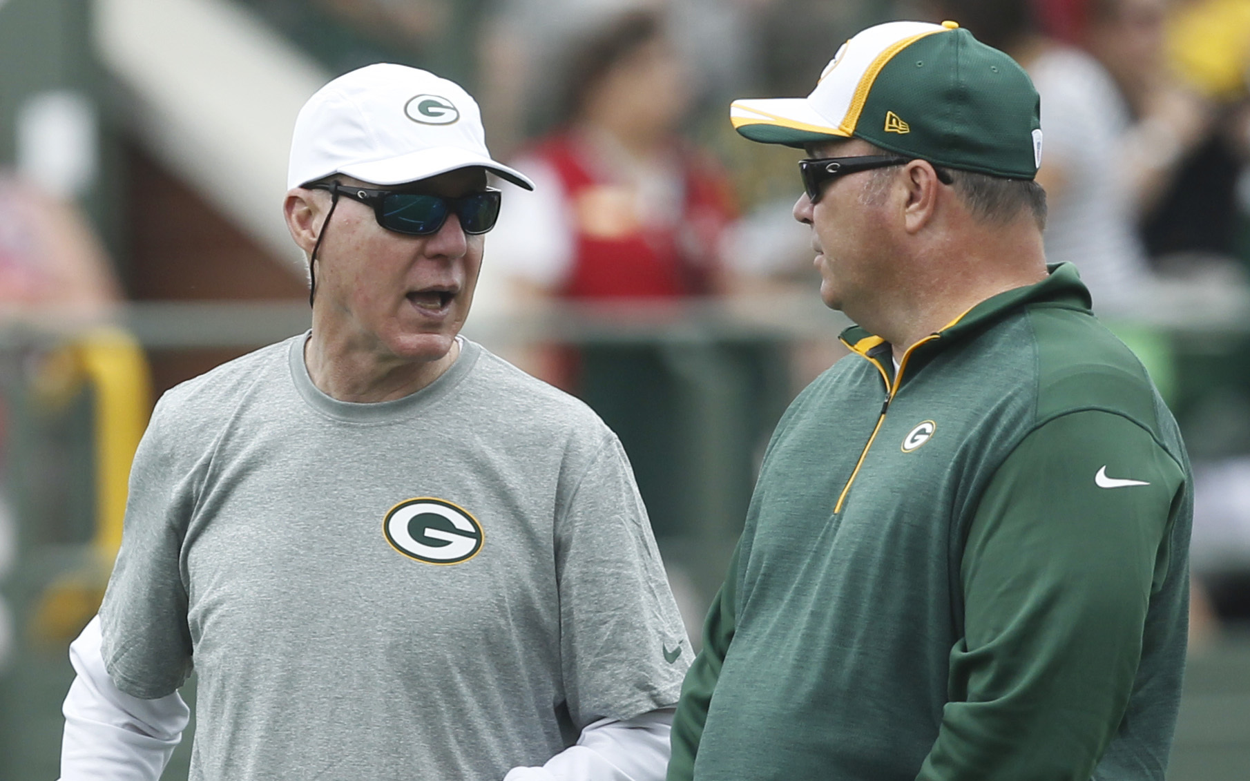 Green Bay Packers general manager Ted Thompson (left) and head coach Mike McCarthy are shown during the first day of training camp Saturday, July 26, 2014 in Green Bay, Wis.  MARK HOFFMAN/MHOFFMAN@JOURNALSENTINEL.COM