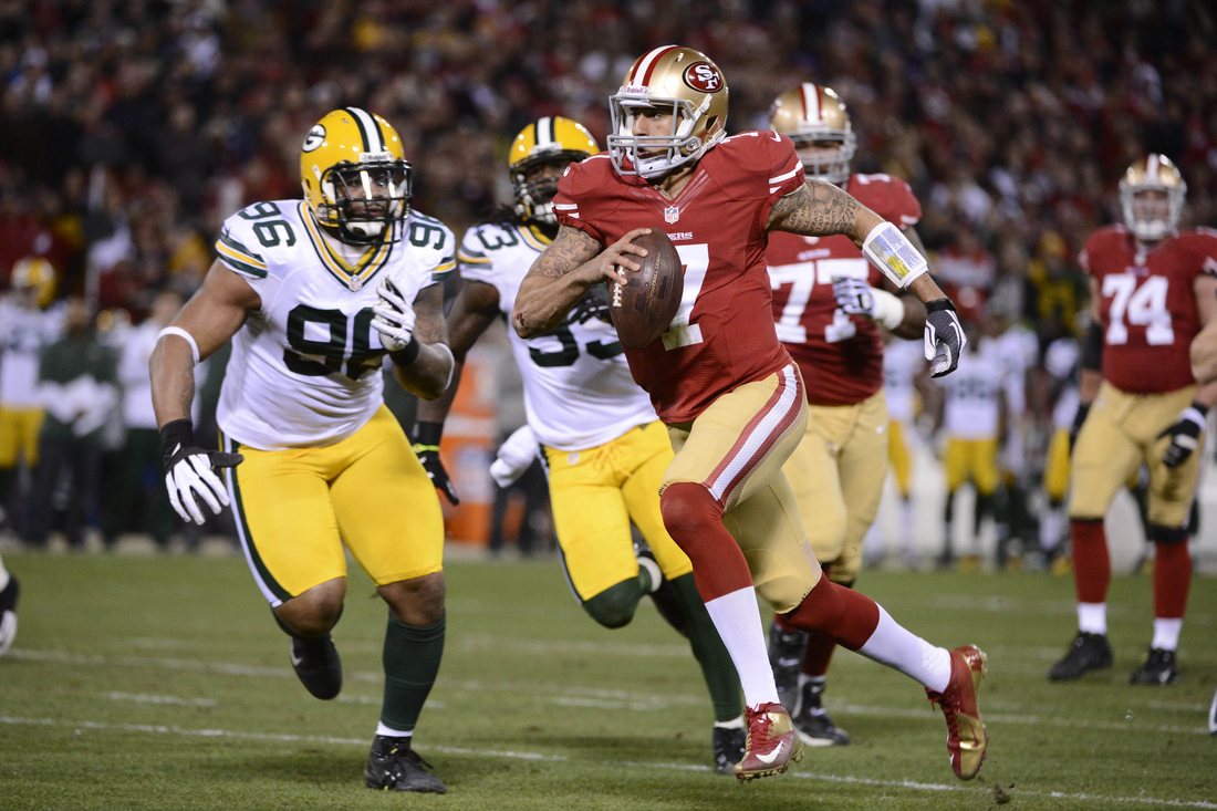 Jan 12, 2013; San Francisco, CA, USA; San Francisco 49ers quarterback Colin Kaepernick (7) runs past Green Bay Packers defensive end Mike Neal (96) for a touchdown during the first quarter of the NFC divisional round playoff game at Candlestick Park.  Mandatory Credit: Robert Hanashiro-USA TODAY Sports