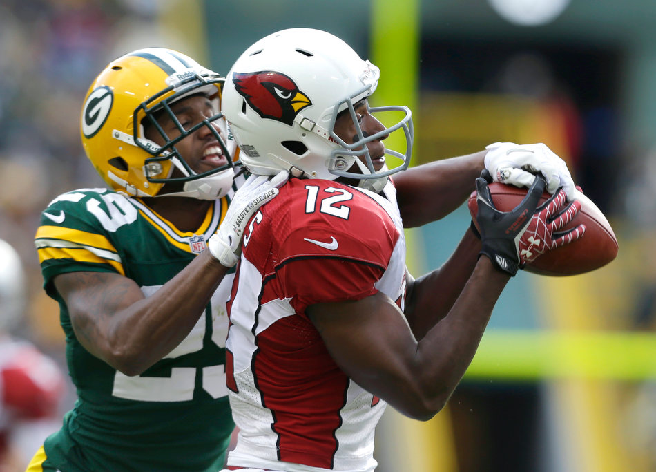 Arizona Cardinals' Andre Roberts (12) catches a pass next to Green Bay Packers' Casey Hayward, left, during the first half of NFL football game Sunday, Nov. 4, 2012, in Green Bay, Wis. (AP Photo/Jeffrey Phelps)