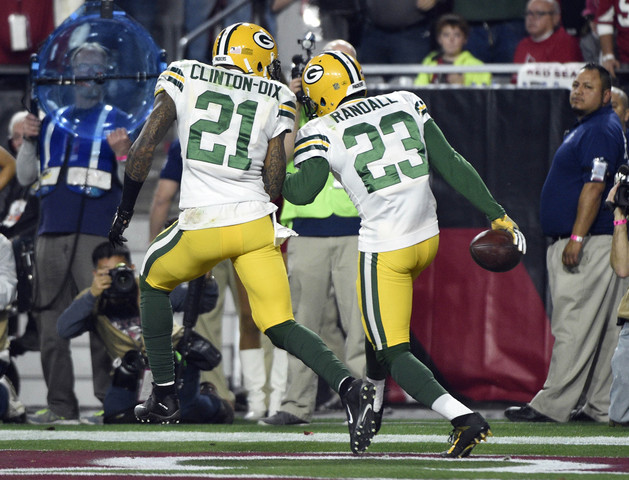 January 16, 2016; Glendale, AZ, USA; Green Bay Packers cornerback Damarious Randall (23) celebrates with free safety Ha Ha Clinton-Dix (21) his interception against Arizona Cardinals during the second half in a NFC Divisional round playoff game at University of Phoenix Stadium. Mandatory Credit: Kyle Terada-USA TODAY Sports